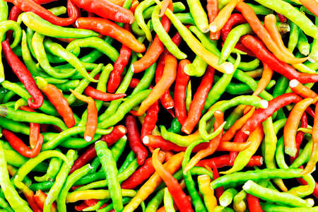 Fresh green,orange,yellow and red chili pepper texture abstract background