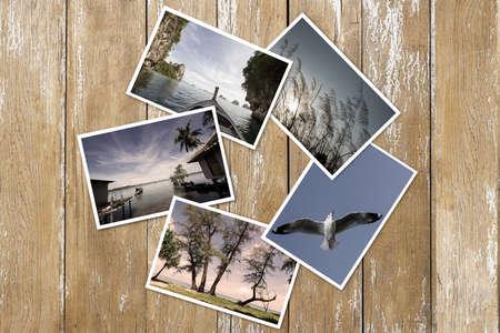 Old photos stack on vintage grunge wooden background Standard-Bild