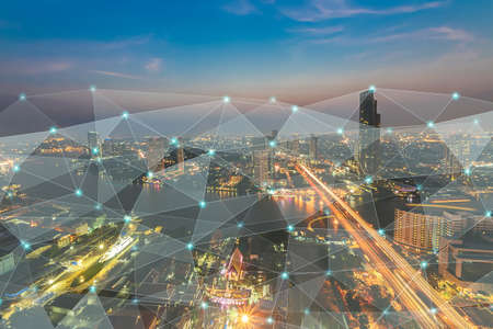 Smart city at night with network connections aerial view, communication business technology concept Stock fotó