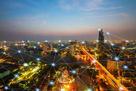 Smart city at night with network connections aerial view, communication technology concept