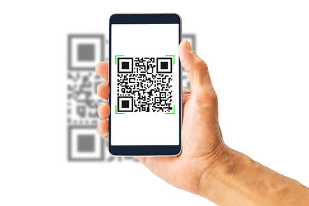 Hand holding smartphone scanning QR code isolated on white background