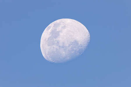 Moon in the afternoon on blue sky background
