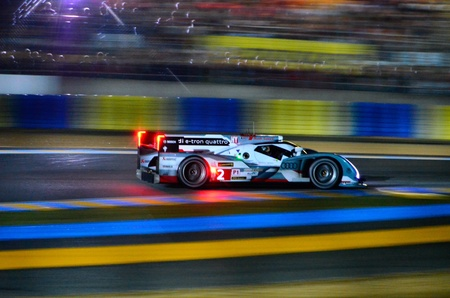 le: An Audi R18 racing at the 2013 Le Mans 24 Hours