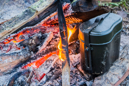 boiling rice by campfire photo