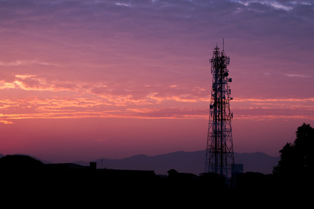 Silhouettes telecommunication tower at sunrise and twilight cloud and sky.