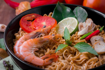 thai noodle soup: Tom Yum Kung with noodles is popular Thai dish cuisine. Stock Photo