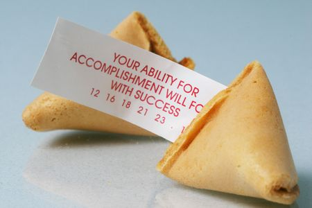 Open fortune cookie with fortune sticking out