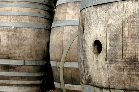 Close up of several old oak wine barrels. Stock Photo