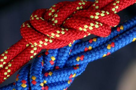 Two figure eight follow through knots in a climbing rope. Stock Photo