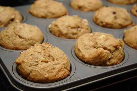 Banana nut muffins fresh from the oven. Stock Photo