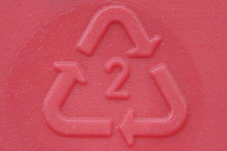 Plastic imprint  of recycle symbol.