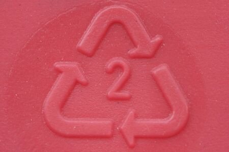 Plastic imprint  of recycle symbol.