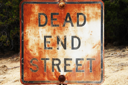 Rusted and weathered Dead End sign.