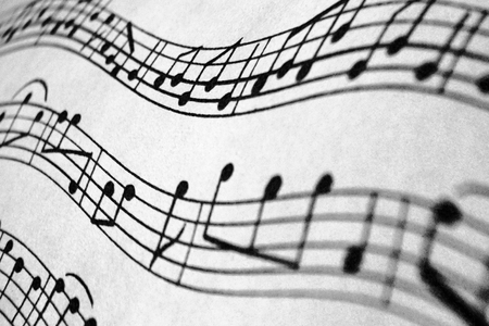 Waves of music notes in black and white. Stock Photo