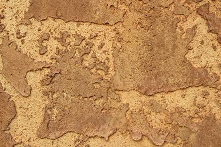 Rund mudded Stuck Wand Textur in den reichen braun.