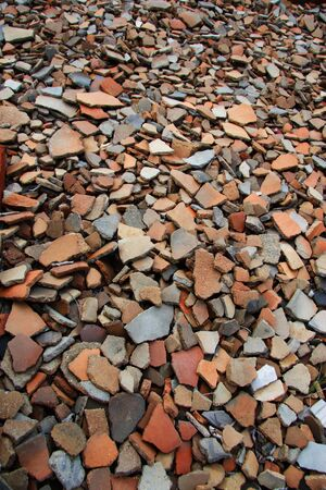 archaeologists: Shards of Native American pottery scattered on the ground.
