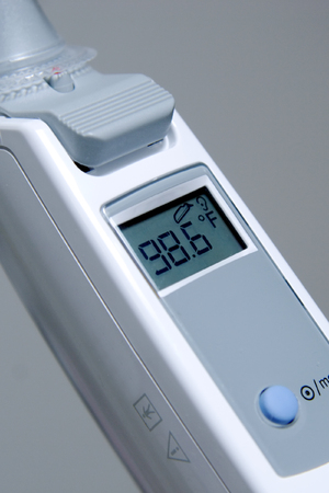 Digital thermometer showing the temp at a normal, healthy 98.6 degrees.
