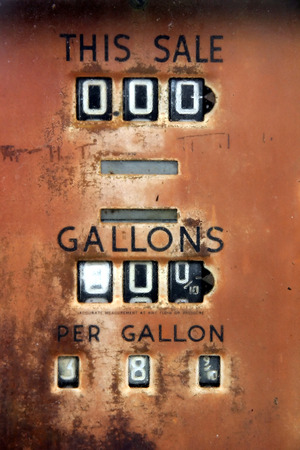 gallons: Very old gas pump showing the price of 38 cents per gallon. Stock Photo