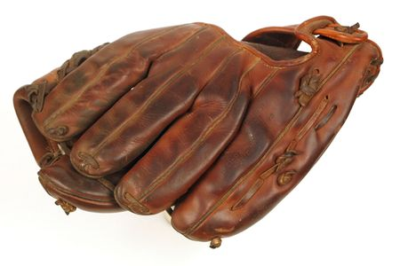 A well worn, very broken in, vintage leather baseball glove.