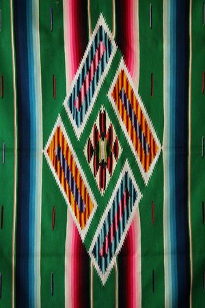 Colorful central medallion of a woven mexican sarape.