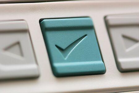 Center button in green with checkmark for confirmation Archivio Fotografico