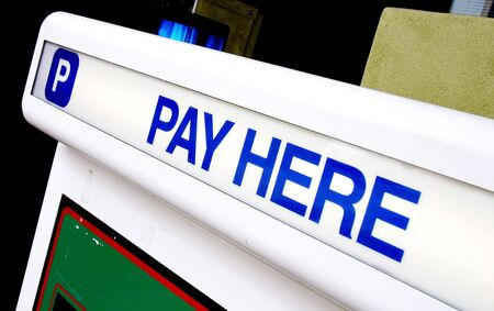 Parking garage pay kiosk sign - Pay Here Stock Photo