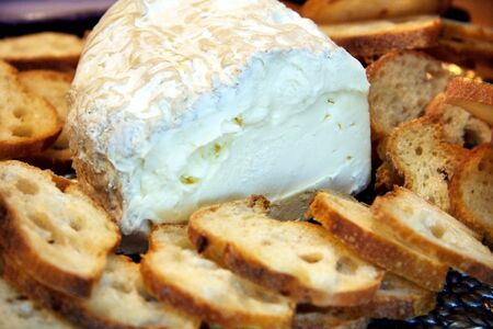 Plate of sliced french baguette and soft cheese appetizer