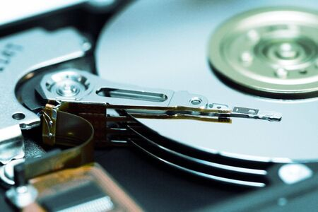 Very clean internal mechanism of a computer hard drive with reader arm and platters Stock Photo