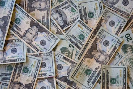 careless: A disorderly pile of united states twenty dollar bills