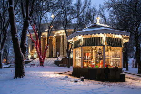 Holiday lights in the fresh snow around decorated gazebo at the Yavapai County Courthouse in Prescott, Arizona