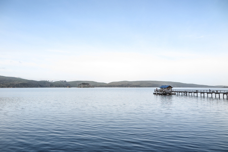 Tomales Bay, California, USA in the early morning, with pier and small boat shack