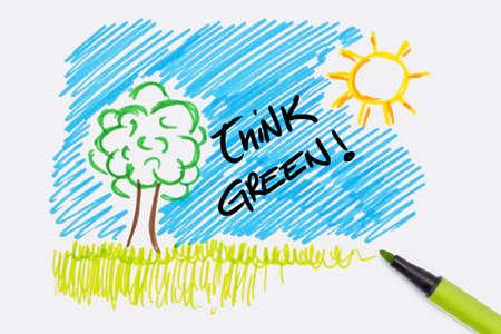 think green: pintura de la mano con el texto de pensar en verde