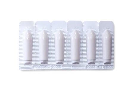 suppository: pack of suppositiories on white background with clipping path Stock Photo