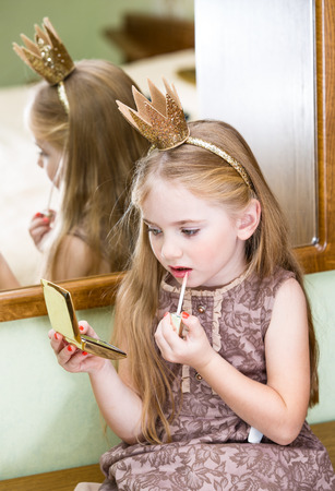 lip gloss: The little princess with lip gloss Stock Photo