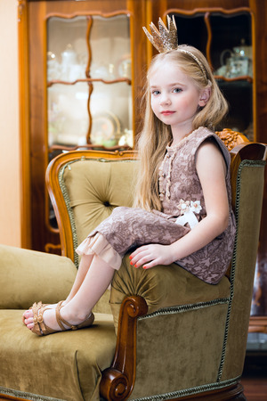 sitting pretty: Little girl with crown