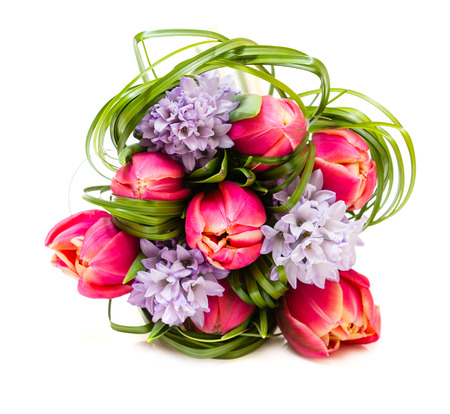 tulips in green grass: Bouquet of pink tulips and green grass on green background