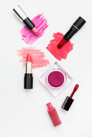 Makeup blush and lipsticks on white background. Stock Photo