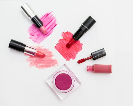 colorswatch: Makeup blush and lipsticks on white background. Stock Photo