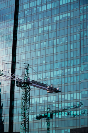 building crane on a background of high-rise buildings and blue sky Stock Photo