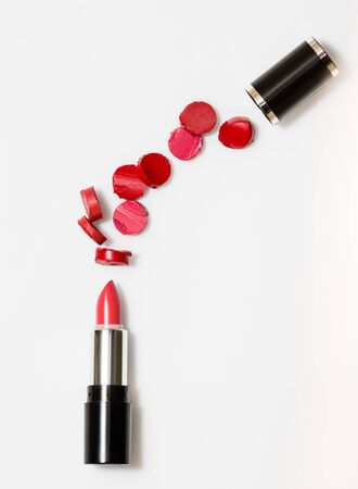 red sliced pieces between lipstick and cap