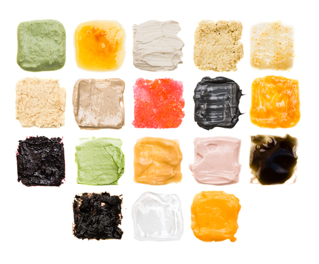 A lot of samples of different textures of cosmetics on a white background