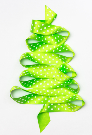 Christmas tree from green ribbon tape isolated on a white background
