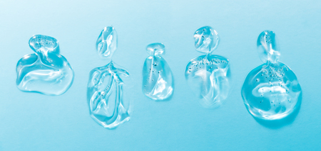 Perfume bottles made from gel and water on a blue background