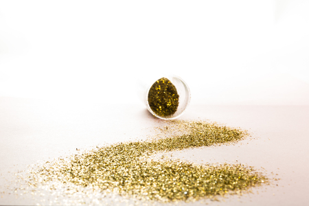 A jar with a track of scattered gold spangles.