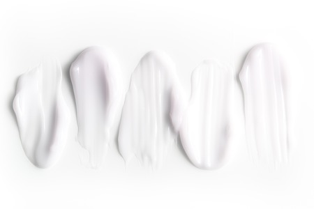 A group of textured strokes of moisturizers on a white background. Stockfoto