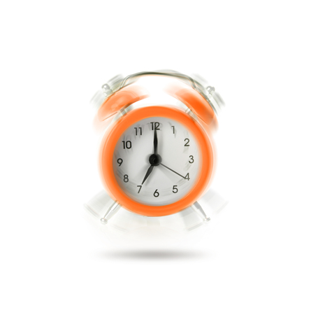 Orange ringing alarm clock isolated on white background.
