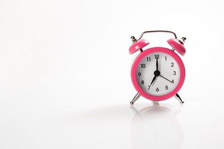 Alarm clock with shadow and space for your presentation text. Stock Photo