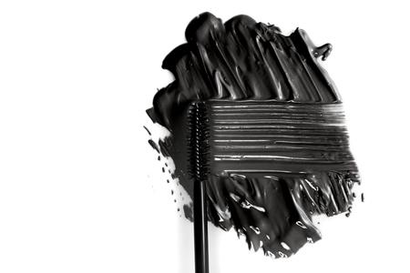 Black mascara brush stroke with applicator brush isolated on white Banco de Imagens