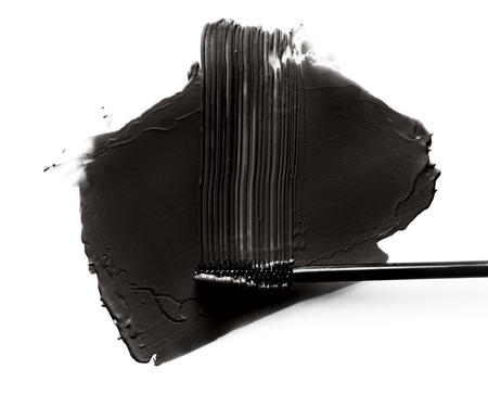 closeup black mascara brush strokes isolated on white
