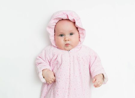 Cute baby dressed in warm overall for winter cold weather.